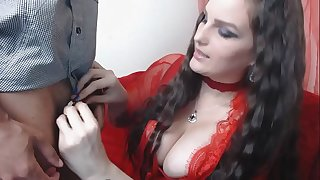Hot Mistress locking male sub in Chastity cage